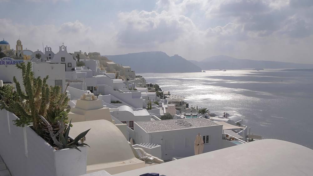 Slider shot of white washed village of Oia, Santorini, Cyclades, Greek Islands, Greece, Europe