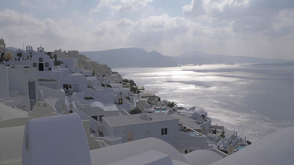 Crane shot of white washed village of Oia, Santorini, Cyclades, Greek Islands, Greece, Europe