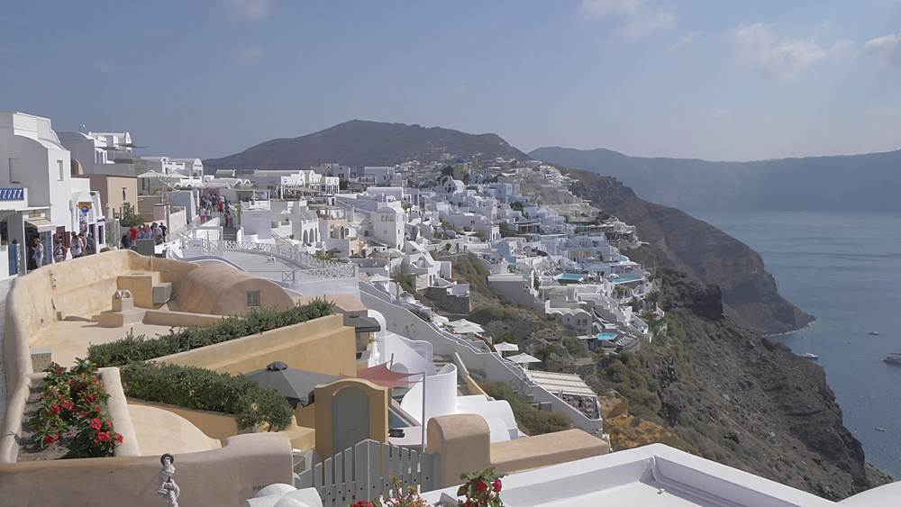 Crane shot of white washed village of Oia, Santorini, Cyclades, Greek Islands, Greece, Europe