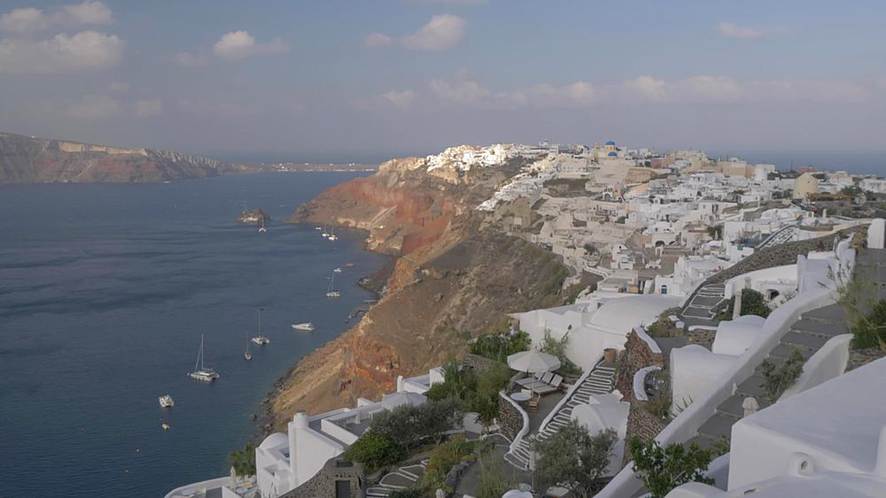 Panning view of Mediterranean Sea and Oia during morning, Santorini, Cyclades, Greek Islands, Greece, Europe