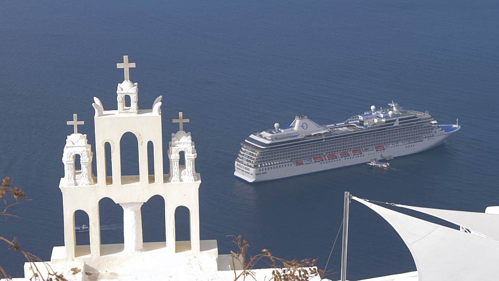 View of white washed church and cruise ship at Fira, Santorini, Greek Islands, Greece, Europe
