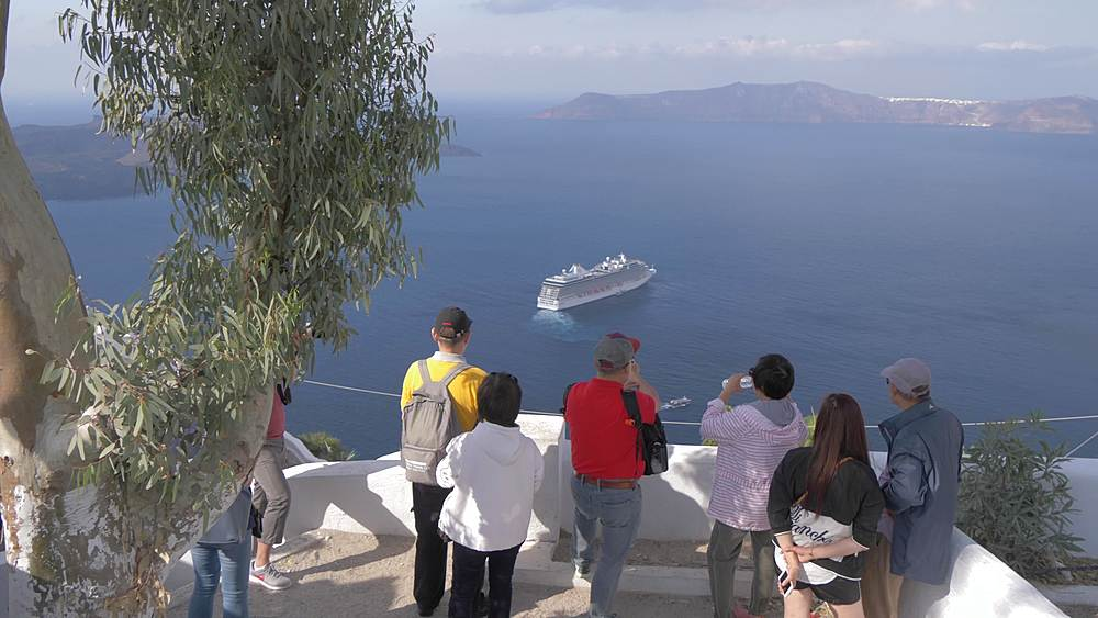View of visitors at elevated position overlooking cruise ship at Fira, Santorini, Greek Islands, Greece, Europe
