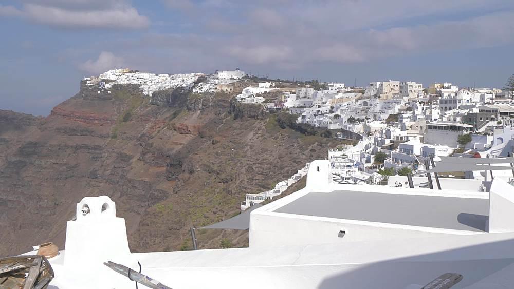 View of white washed villas and Skaros Rock at Fira, Santorini, Greek Islands, Greece, Europe