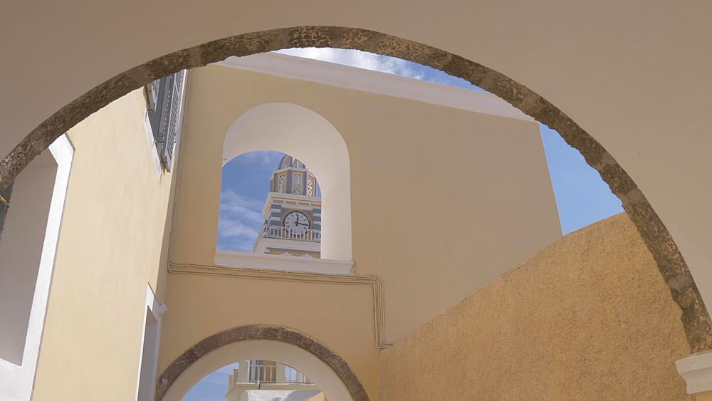 Slider shot of Church Ag Loannis Baptistis, Fira, Santorini, Greek Islands, Greece, Europe