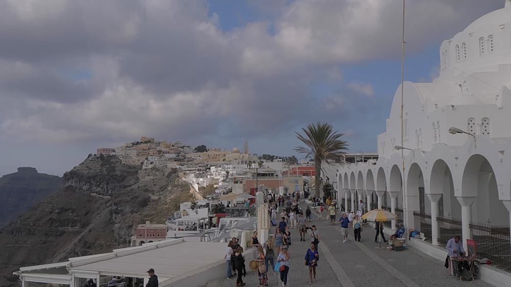 Panning shot of Orthodox Metropolitan Cathedral and old town, Fira, Santorini, Cyclades, Greek Islands, Greece, Europe