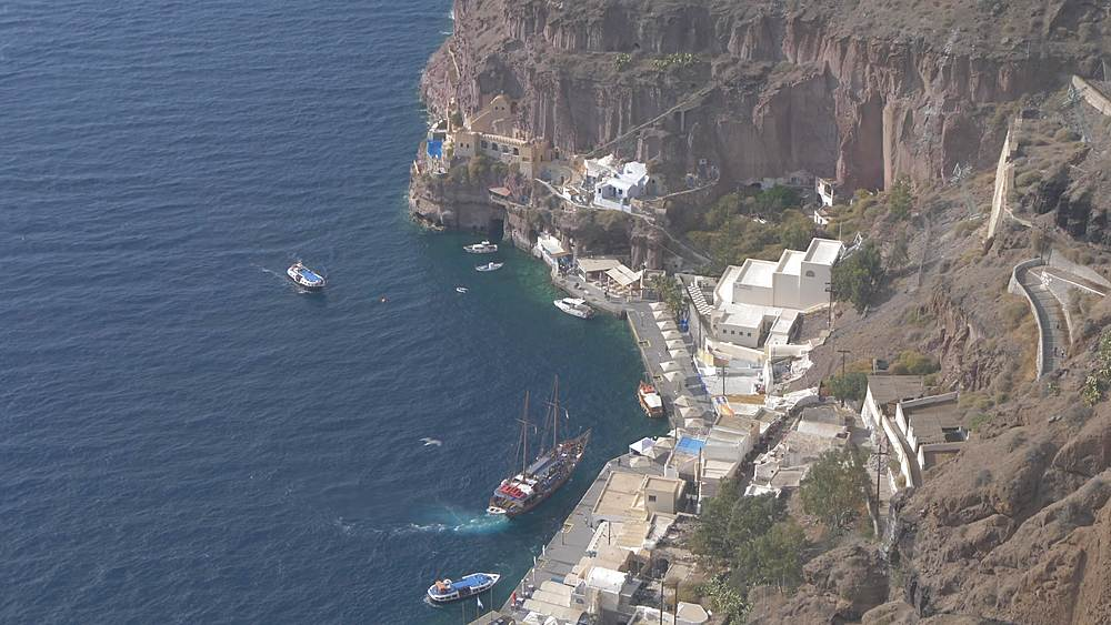 Elevated view of Port and ship arriving in harbour, Fira, Santorini, Cyclades, Greek Islands, Greece, Europe