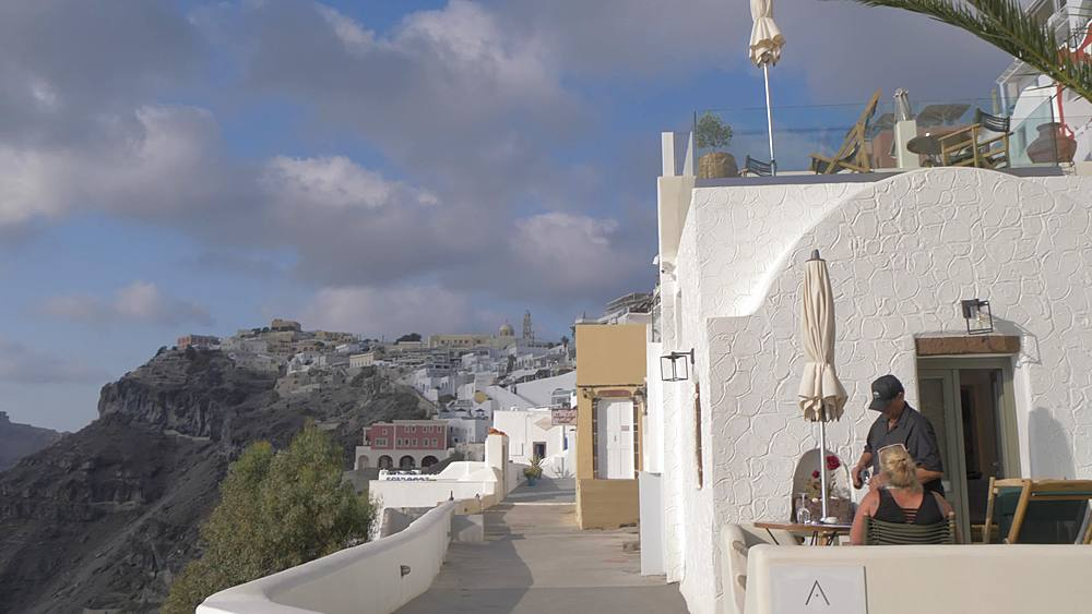 Crane shot from traditional church to whitewashed houses, Fira, Santorini, Cyclades, Greek Islands, Greece, Europe