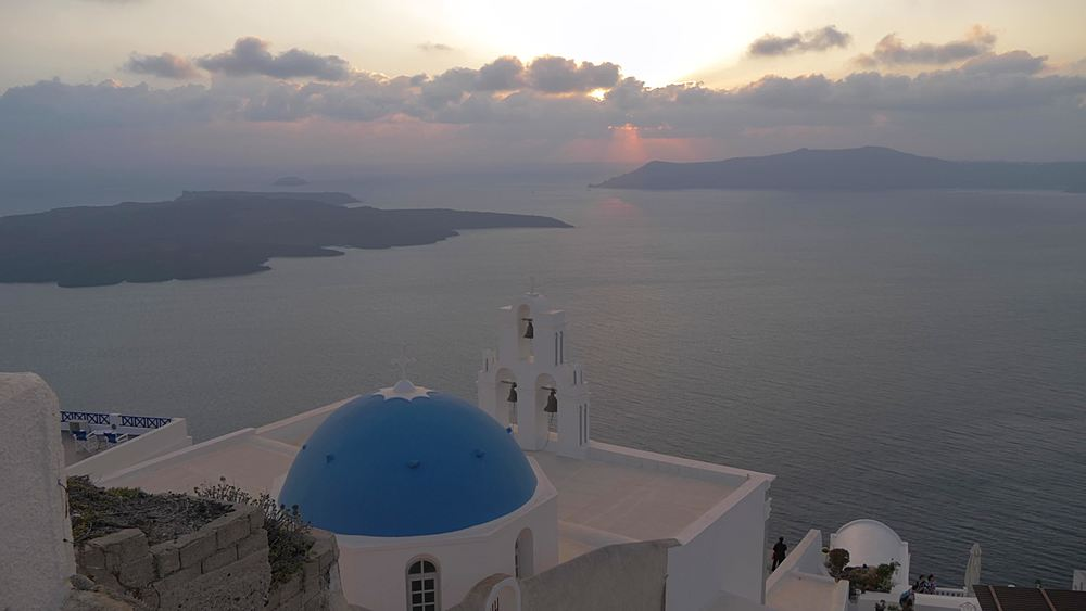 View of Blue dome and belltower of the church of St. Gerasimos, Firostefani, Fira, Santorini, Cyclades, Greek Islands, Greece, Europe