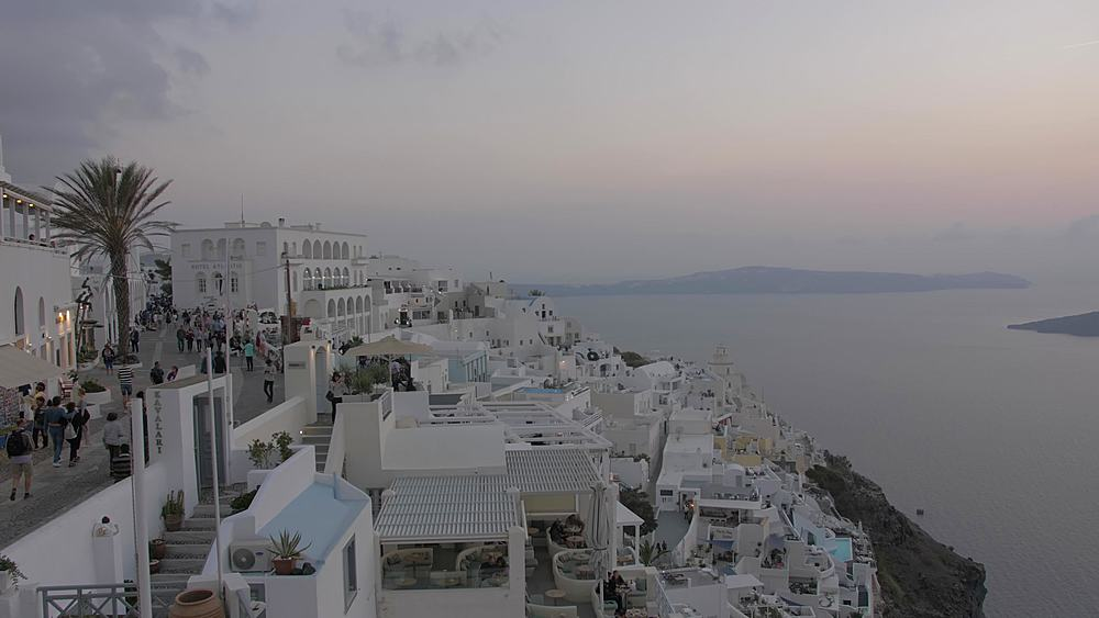 Zoom out shot of town of Fira at dusk, Santorini, Cyclades Islands, Greek Islands, Greece, Europe