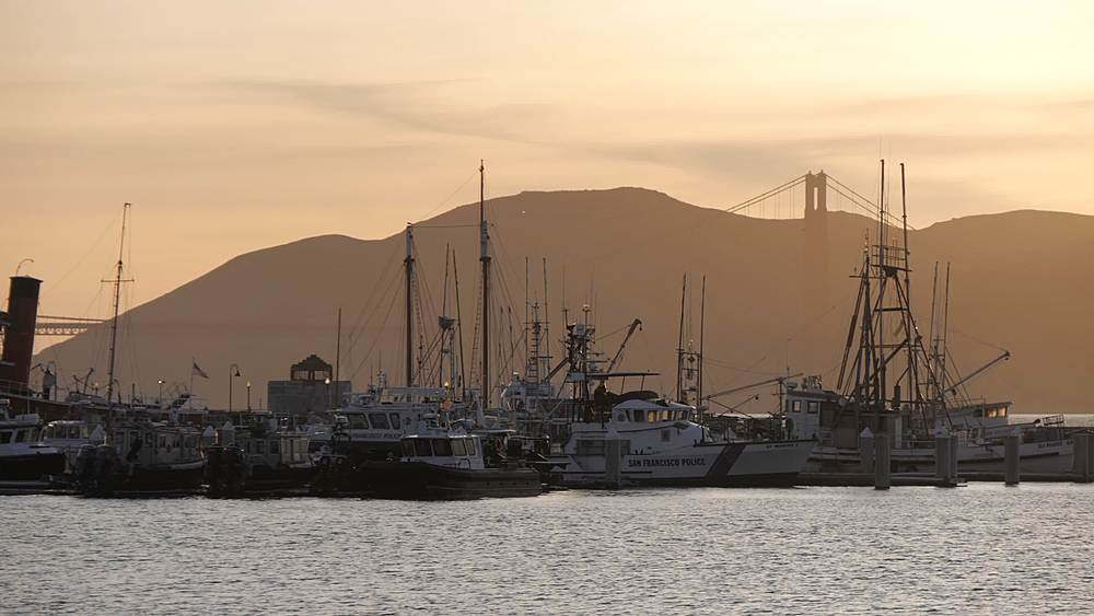 View of harbour boats and Golden Gate Bridge in background, Fisherman?s Wharf, San Francisco, California, United States of America, North America