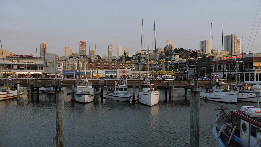 View of restaurants and city skyline from Fisherman?s Wharf at sunset, Fisherman?s Wharf, San Francisco, California, United States of America, North America - 844-18515