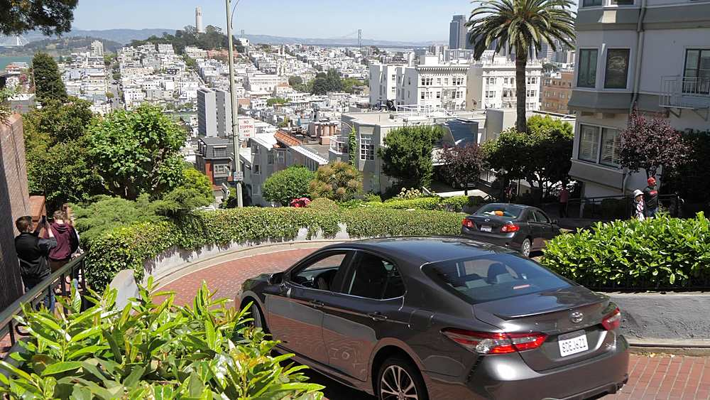 Crane shot of Lombard Street and Coit Tower in background, San Francisco, California, United States of America, North America