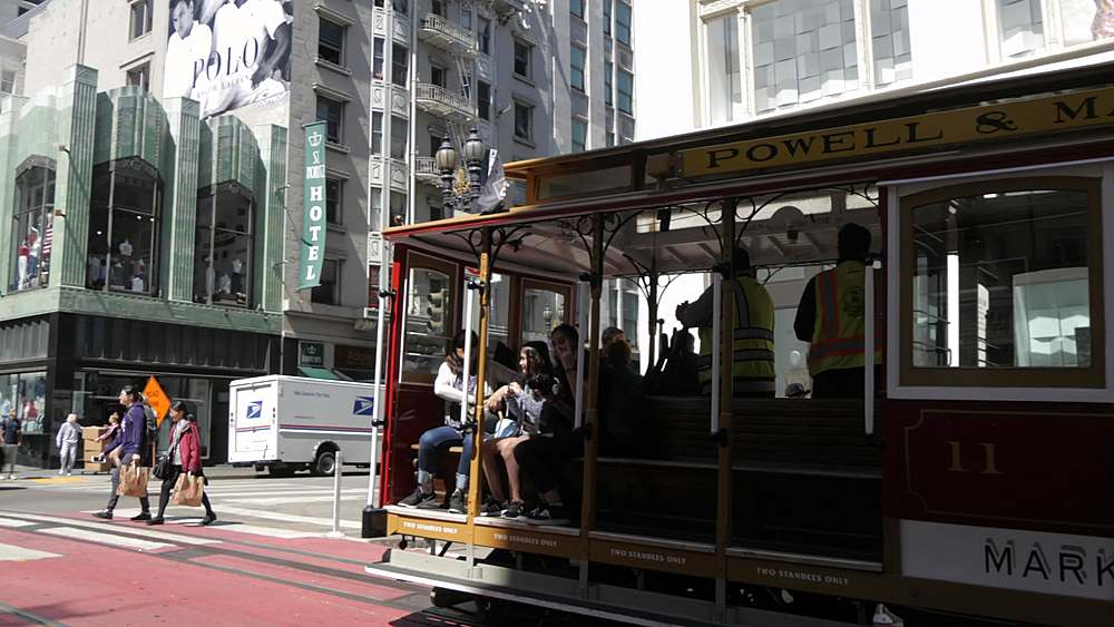 Pan shot of cable car on Powell Street, San Francisco, California, United States of America, North America