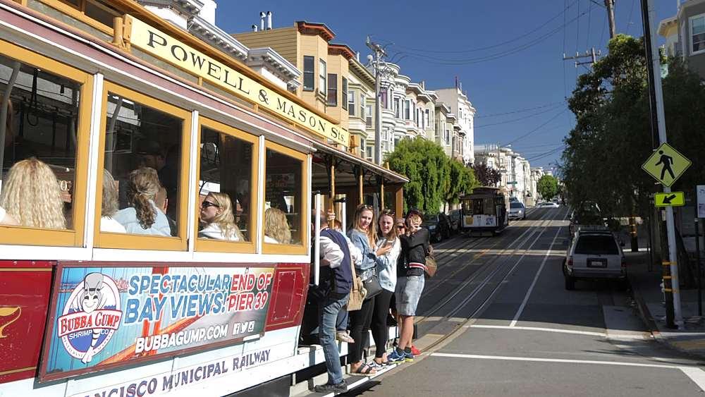 People riding tram on Columbus Avenue, San Francisco, California, United States of America, North America