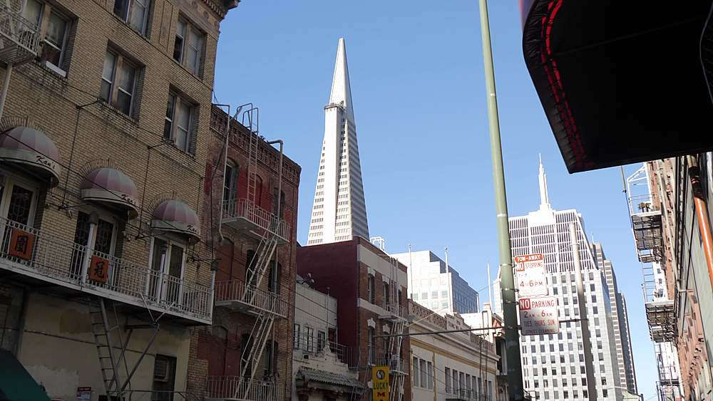 Tracking shot of Transamerica Pyramid and Grant Street in Chinatown, San Francisco, California, United States of America, North America - 844-18553