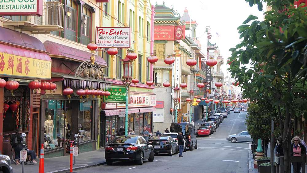Slider shot of Chinese lanterns and restaurants on Grant Street in Chinatown, San Francisco, California, United States of America, North America