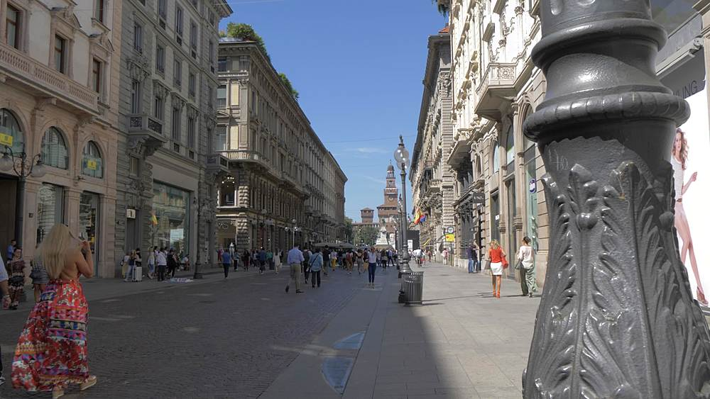 Slider shot of Via Dante with Castello Sforzesco visible in background, Milan, Lombardy, Italy, Europe