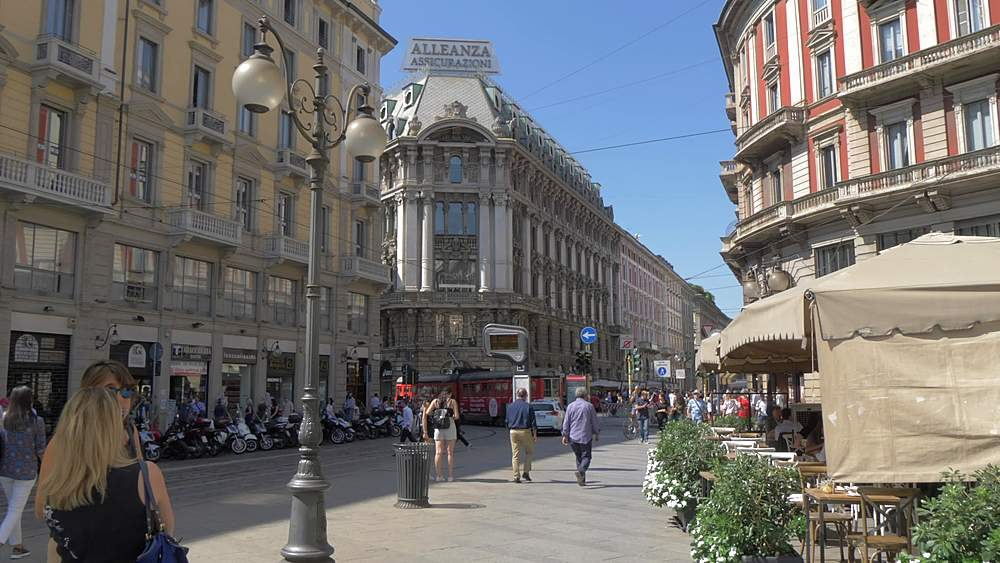Reverse tracking shot on Via Dante of tram and restaurant, Milan, Lombardy, Italy, Europe - 844-18596