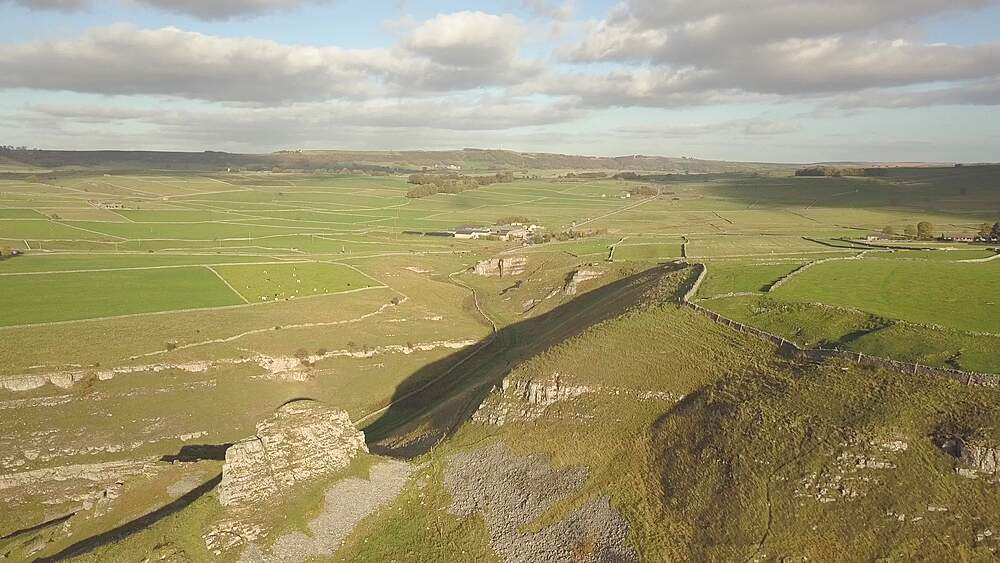Drone shot of vale, fields and dry stone walls between Wardlow and Litton, Peak District National Park, Derbyshire, England, UK, Europe - 844-18618