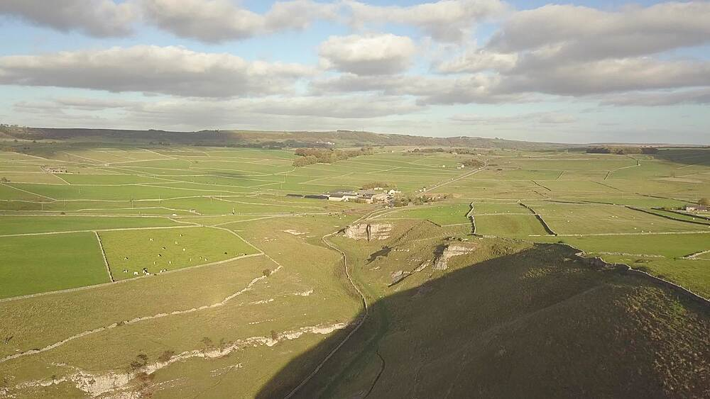 Drone shot of vale, fields and dry stone walls between Wardlow and Litton, Peak District National Park, Derbyshire, England, UK, Europe