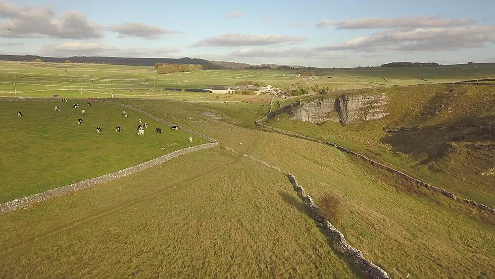 Drone shot of vale, fields and dry stone walls between Wardlow and Litton, Peak District National Park, Derbyshire, England, UK, Europe - 844-18623