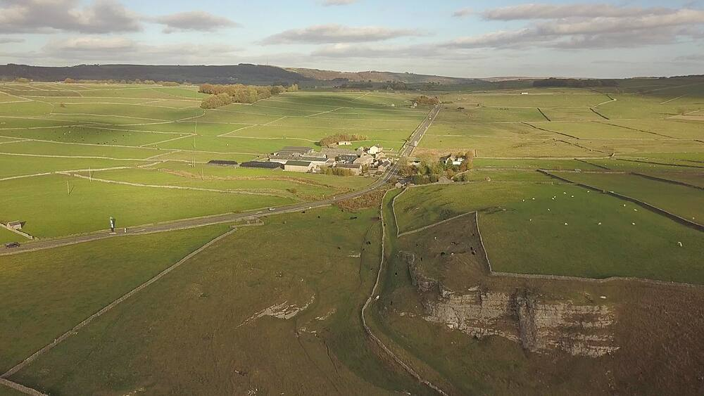 Drone shot of fields and dry stone walls between Wardlow and Litton, Peak District National Park, Derbyshire, England, UK, Europe