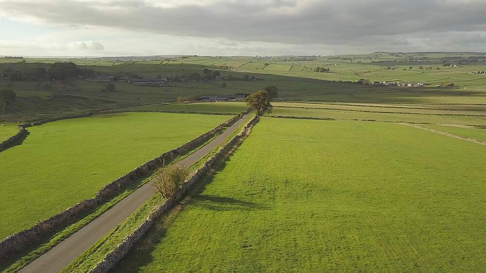 Drone shot of fields and dry stone walls near Wardlow, Peak District National Park, Derbyshire, England, UK, Europe - 844-18632