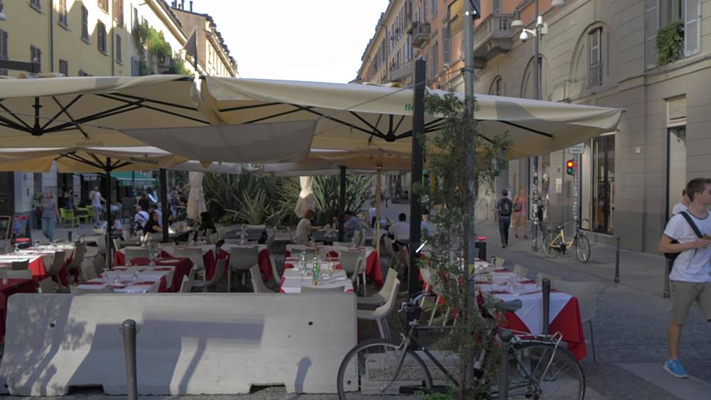 Tracking shot of people, restaurants and Porta Garibaldi, Milan, Lombardy, Italy, Europe - 844-18692
