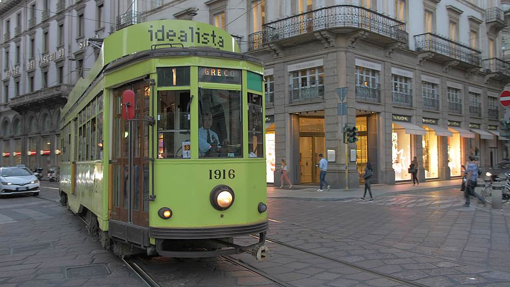 Panning shot of tram outside Teatro alla Scala, Opera House at dusk, Milan, Lombardy, Italy, Europe - 844-18696