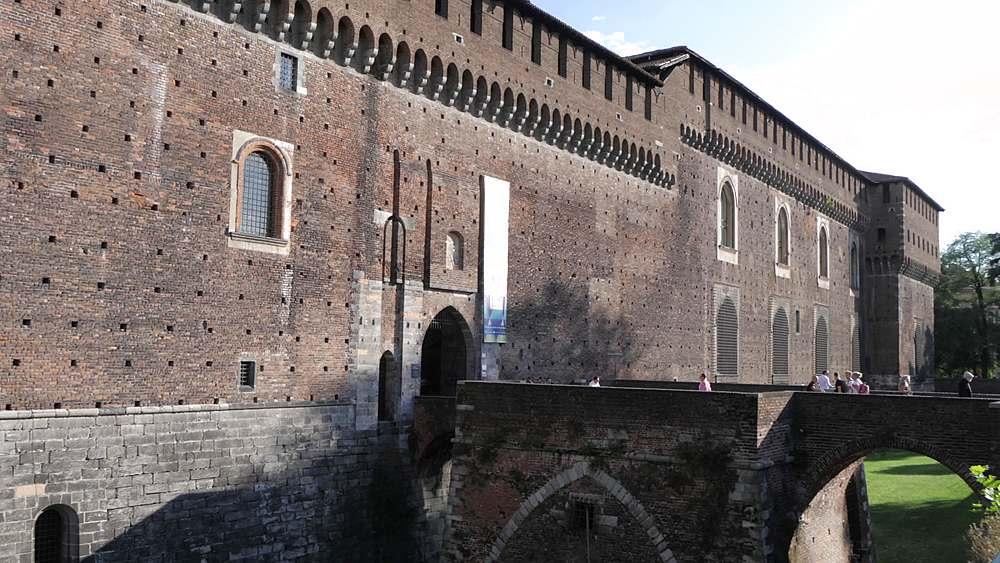 Pan shot of Castello Sforzesco exterior wall and bridge, Milan, Lombardy, Italy, Europe