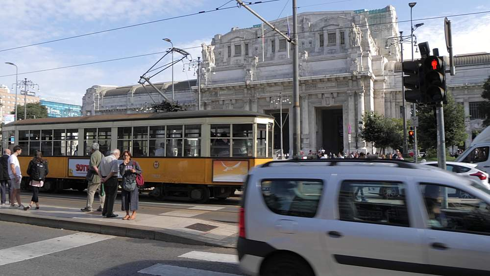 Panning shot of traffic and tram outside Central Station, Milan, Lombardy, Italy, Europe - 844-18715