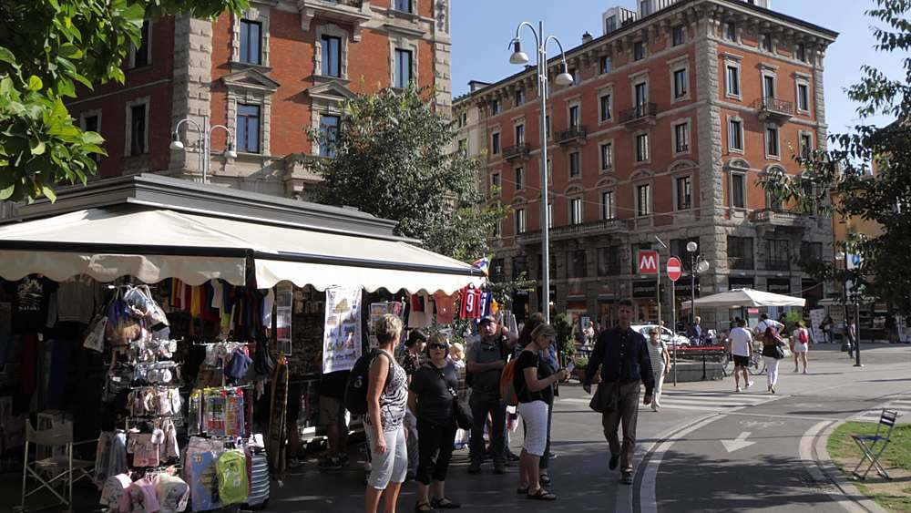 Still shot of souvenir stall and people Cairoli Castello, Milan, Lombardy, Italy, Europe