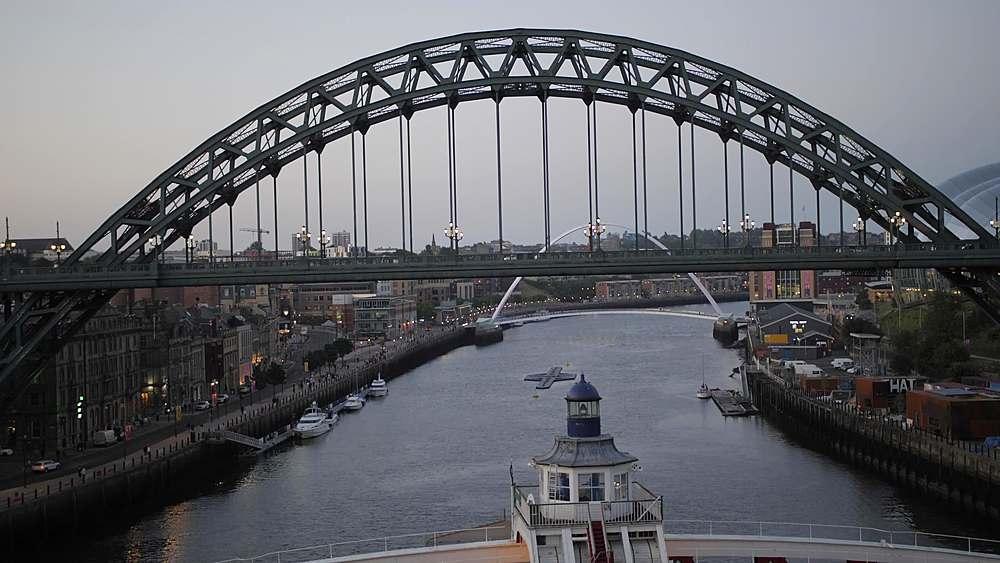 Tilt shot of Swing Bridge and Tyne Bridge from High Level Bridge at dusk, Newcastle-upon-Tyne, Tyne and Wear, England, United Kingdom, Europe