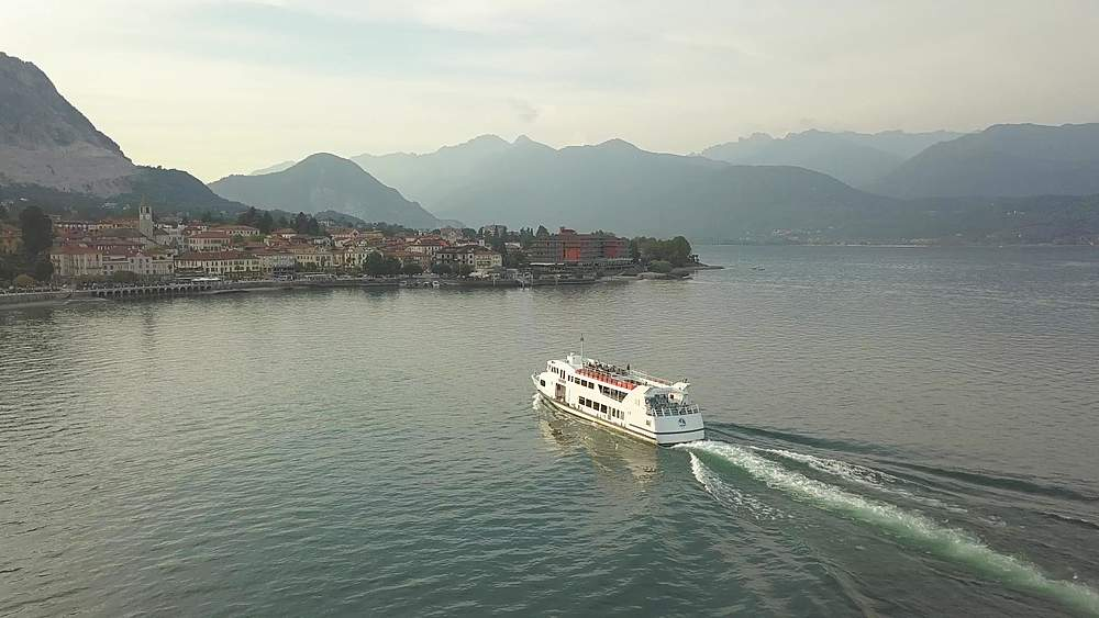 Flight over Lake Maggiore following ferry boat into Stresa, Piedmont, Italy, Europe - 844-18816