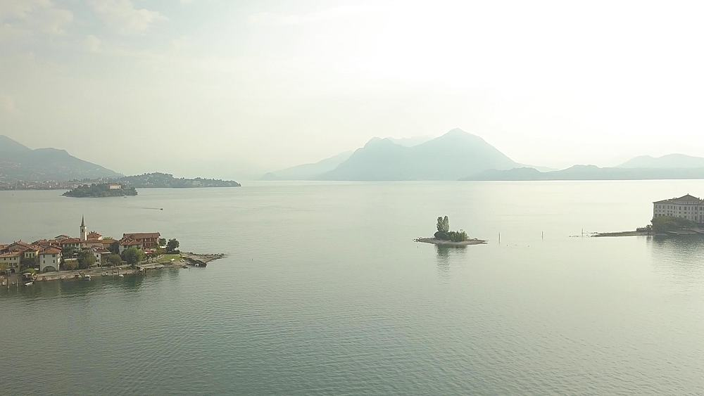 Flight over Lake Maggiore towards Borromean Islands near Stresa at sunrise, Piedmont, Italy, Europe - 844-18835