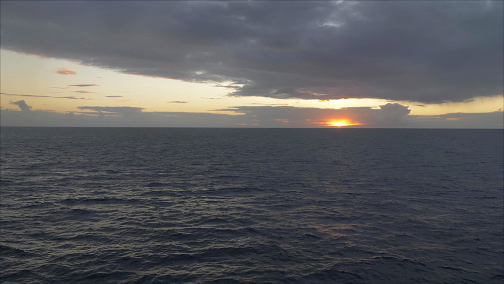 Generic shot of sun setting on Caribbean Sea from moving cruise ship, West Indies, Caribbean, Central America - 844-19019