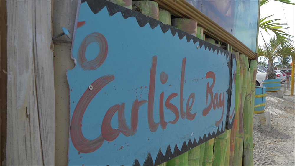 Crane shot of entry sign to Carlisle Beach, Bridgetown, Barbados, West Indies, Caribbean, Central America - 844-19065