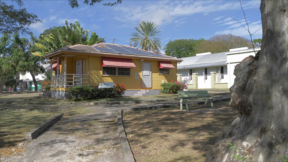 Slider shot of colourful house at entrance to Queens Park, Bridgetown, Barbados, West Indies, Caribbean, Central America - 844-19093