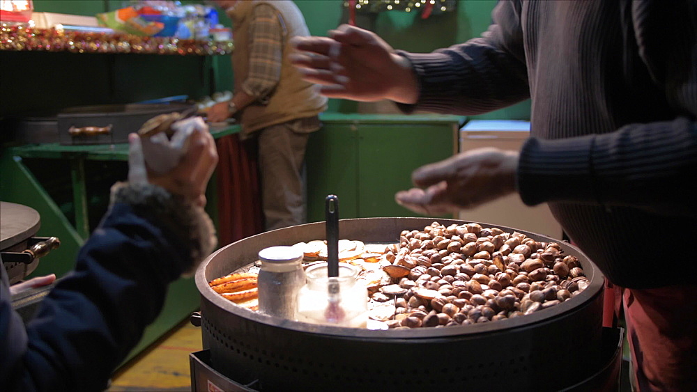 Shot of roasted chestnuts stall on market stall on Rathausplatz at Christmas, Vienna, Austria, Europe