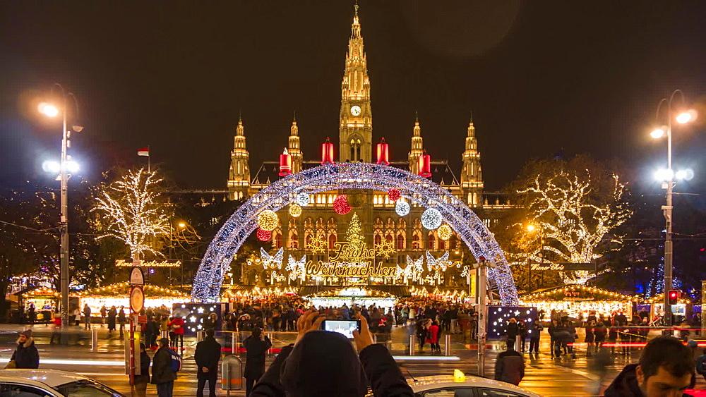 Time Lapse of traffic and Christmas Market in Rathausplatz at night, Vienna, Austria, Europe