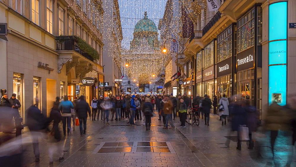 Time Lapse of Christmas lights and people on Kohlmarkt at Christmas, Vienna, Austria, Europe