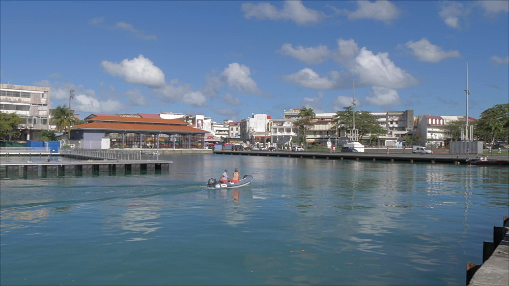 Boat entering harbour, Pointe-a-Pitre, Guadeloupe, French Antilles, West Indies, Caribbean, Central America
