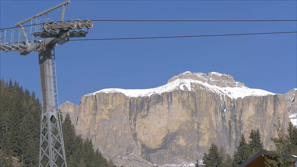 View of cable cars from Canazei and Piz Boe on sunny day in winter, Province of Trento, Trentino-Alto Adige/Sudtirol, Italian Dolomites, Italy, Europe