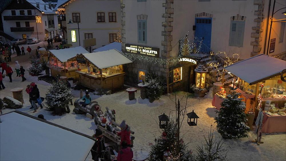 Christmas Market in Campitello di Fassa at dusk, Campitello di Fassa, Province of Trento, Italy, Europe
