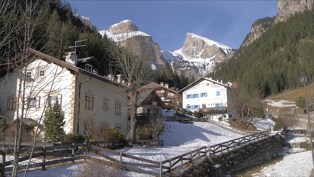 View of river and houses in Fontanazzo in winter, Province of Trento, South Tyrol, Italy, Europe