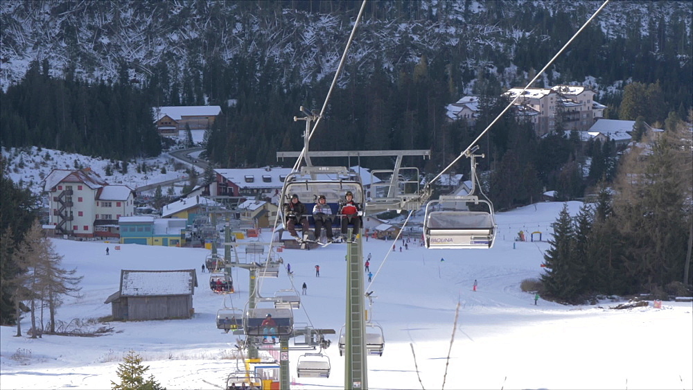 View of ski chairs and Carezza in background, Province of Trento, South Tyrol, Italy, Europe