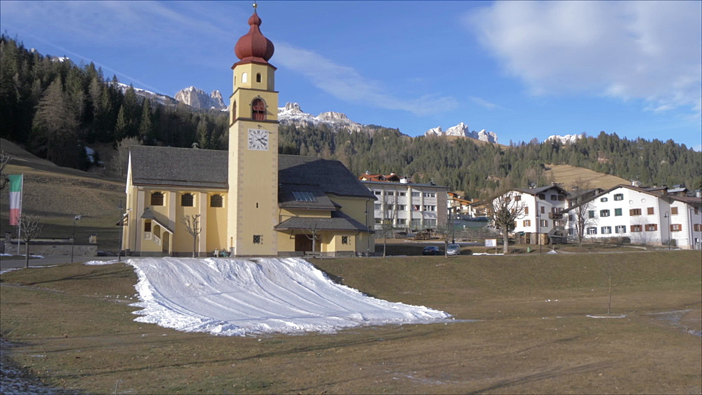 Panoramic view of Soraga on sunny day in winter, Province of Trento, Italian Dolomites, Italy, Europe