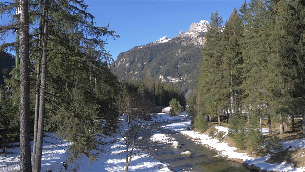 View of Avisio River in Canazei on sunny day in winter, Province of Trento, Italian Dolomites, Italy, Europe