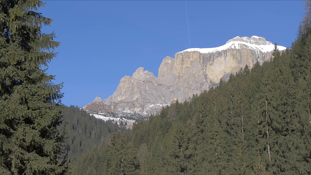 View of Langkofel from Canazei on sunny day in winter, Province of Trento, Italian Dolomites, Italy, Europe