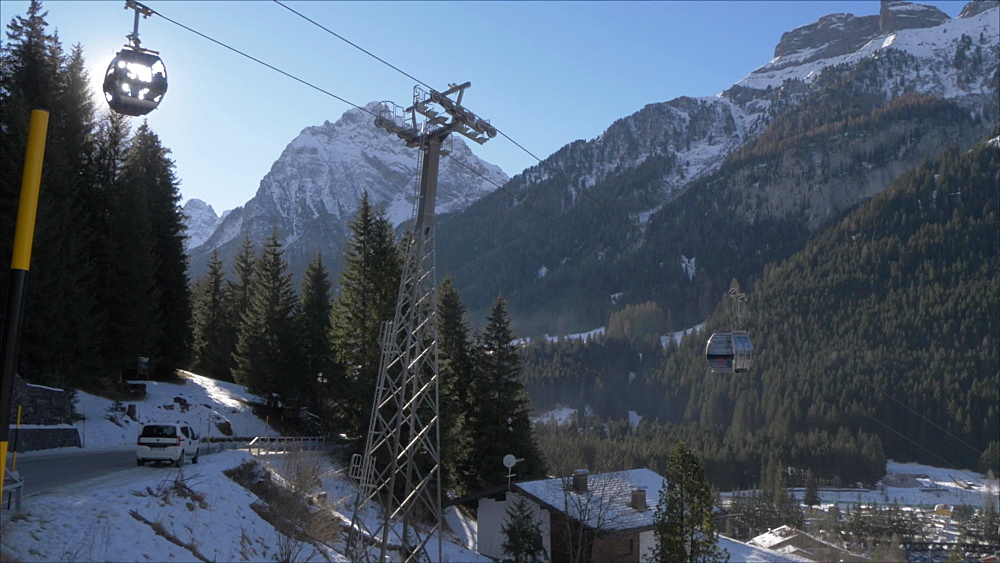 View of cable cars and Canazei on sunny day in winter, Province of Trento, Italian Dolomites, Italy, Europe